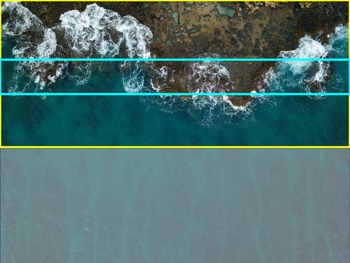 A picture of a coastline, taken from above. The bottom half of the image is greyed out, indicating that it will be removed.