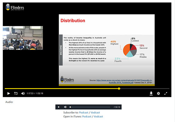 A lecture recording. The video has two areas of focus - a small picture of the lecturer and a large picture of a PowerPoint.